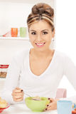 Lovely housewife with cup of muesli Royalty Free Stock Photos