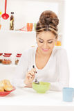 Lovely housewife with cup of muesli Stock Image