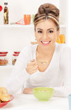 Lovely housewife with cup of muesli Stock Photo