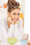 Lovely housewife with cup of muesli Stock Images