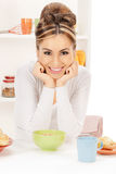 Lovely housewife with cup of muesli Royalty Free Stock Image