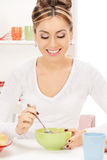 Lovely housewife with cup of muesli Royalty Free Stock Photo