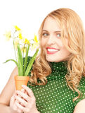Lovely housewife with flower Stock Photography