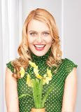 Lovely housewife with flower Stock Photos