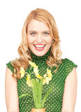 Lovely housewife with flower Stock Images