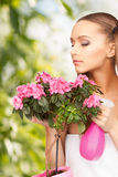 Lovely housewife with flowers Royalty Free Stock Photos