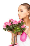Lovely housewife with flowers Stock Photos