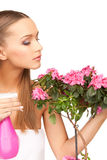 Lovely housewife with flowers Royalty Free Stock Photography