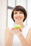 Lovely housewife with green apple Royalty Free Stock Photo