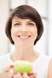 Lovely housewife with green apple Royalty Free Stock Image