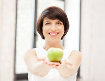 Lovely housewife with green apple Royalty Free Stock Images