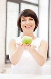 Lovely housewife with green apple Royalty Free Stock Photos