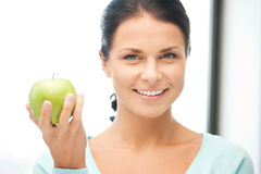 Lovely housewife with green apple Stock Images