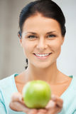 Lovely housewife with green apple Stock Photography