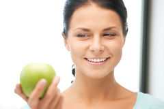 Lovely housewife with green apple Royalty Free Stock Photography