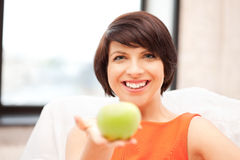 Lovely housewife with green apple Stock Photo
