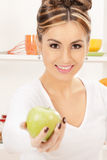Lovely housewife with green apple Stock Image