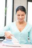 Lovely housewife with iron Royalty Free Stock Photos