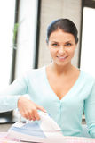 Lovely housewife with iron Royalty Free Stock Image