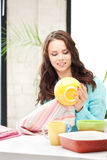 Lovely housewife at the kitchen Royalty Free Stock Images