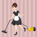 Lovely Housewife Maid. Lovely housewife with vintage maid dress cleaning using vacuum cleaner Royalty Free Stock Photo
