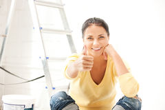 Lovely housewife making repairing works Stock Image