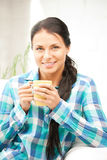 Lovely housewife with mug Stock Photos