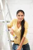 Lovely housewife painting Stock Photo