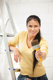 Lovely housewife painting Royalty Free Stock Image