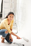 Lovely housewife painting Stock Image