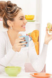 Lovely housewife with sandwich Stock Photography