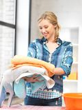 Lovely housewife with towels Stock Photo