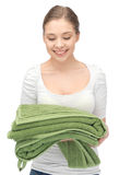 Lovely housewife with towels Royalty Free Stock Photo