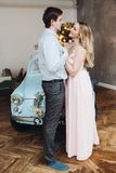 Lovely husband embracing beautiful blonde woman wearing pink dress. royalty free stock photo
