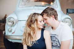 Lovely husband standing from back and embracing beautiful blonde woman. royalty free stock photos