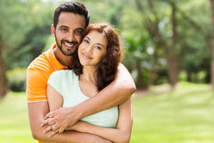 Lovely indian couple. Lovely young indian couple hugging outdoors Stock Photography