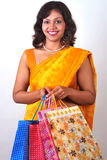 Lovely Indian woman with  shopping bags Royalty Free Stock Image