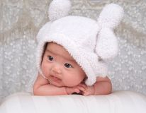 Lovely infant. With a white hat Stock Photography
