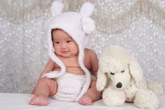 Lovely Infant and Toy. Happy Infant with hat and Toy Stock Photography