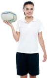 Lovely isolated caucasian teenager with a football Stock Photography