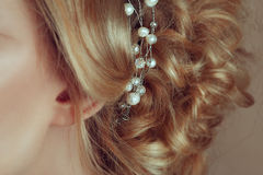 Lovely jewelry for hair. Handmade Jewelry made of pearls on blonde hair. Beauty shoot Royalty Free Stock Images