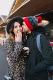 Lovely joyful couple chilling, hugging on street in christmas time. True love emotions, having fun, enjoying. Togetherness, dating, romantic relationship stock image