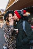 Lovely joyful couple chilling, hugging on street in christmas time. True love emotions, having fun, enjoying stock image