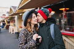Lovely joyful couple chilling, hugging on street in christmas time. True love emotions, having fun, enjoying. Togetherness, dating, romantic relationship royalty free stock image