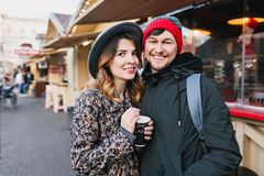 Lovely joyful couple chilling, hugging on street in christmas time. True love emotions, having fun, enjoying. Togetherness, dating, romantic relationship stock images