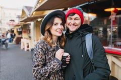 Lovely joyful couple chilling, hugging on street in christmas time. True love emotions, having fun, enjoying stock images