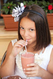 Lovely kid with cocktail in cafe Stock Photography