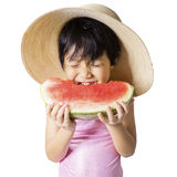 Lovely kid eating watermelon in studio Stock Photography