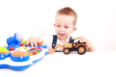 Lovely kid playing. Portrait of lovely boy playing with toys with copy space Royalty Free Stock Images