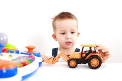 Lovely kid playing. Portrait of lovely boy playing with toys with copy space Stock Photo